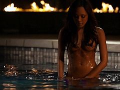 Passionate brunette girl strips her clothes off outdoors. Then this bombshell poses naked in the pool.