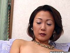 Sex hungry Japanese mature sits on her bed with legs wide open wearing frisky leopard-printed lingerie and fishnet stockings. She toys her bearded vagina before she uses a slim dildo to fuck it intensively in solo sex video by Pornstar.