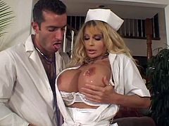 Blonde nurse with big ass and boobs gives passionate blowjob standing on her knees. After that she lies down on a sofa and gets fucked rough.