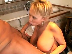 Short-haired blonde milf Carly Parker shows her huge natural tits to some guy and lets him lick her feet. Then she kneels in front of the man and drives him crazy with a blowjob and a titjob.