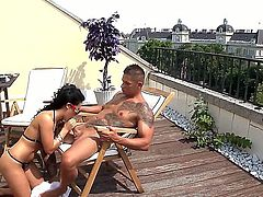 Tight ass black haired Hungarian slut Bettina DiCapri with natural tits and long legs in bikini only sucks long meaty sausage like crazy on rooftop during hot sunny afternoon.
