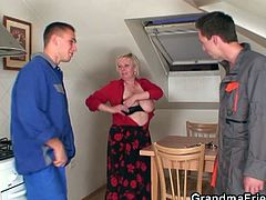 Ugly, busty blonde granny has two boys