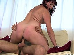 Rapacious brunette mature clings to a sturdy penis of her young insatiable lover to give him a steamy blowjob before she welcome tongue fuck of her hairy cunt in steamy sex video by 21 Sextury.