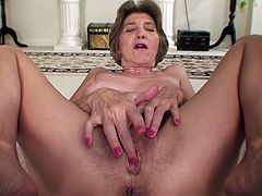 A dirty old slut gets naked for the camera and fucking inserts fingers in that old fucking gash of hers, check it out right here!