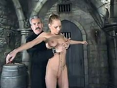 Sexy Livia Choice gets tied up by Lew Rubens in a basement. Then she gets suspended and fucked from behind.