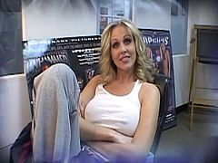 Julia Ann answers a few questions before she poses in sexy black lingerie. Then, she meets Lex, who's going to stretch her pussy with his black dong and cum all over her.