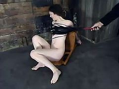 Sexy brunette girl gets wrapped in some black material and toyed. After that this babe gets suspended and whipped. Then she also gets her shaved pussy fingered.