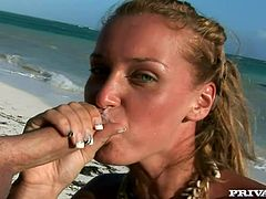 Stunning blonde babe in bikini show her titties and then gives a blowjob right on the beach. Later on she also gets her shaved pussy fingered.