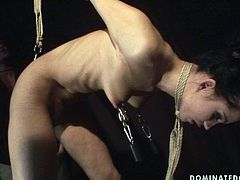 Worn out brunette doxy with a soaking make up gets her tits and hands tied before she inclines to give a blowjob to strain dick. Later he pins her nipples with metal pegs attached to the floor in sick BDSM-involved sex video by 21 Sextury.