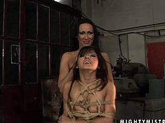 Feisty mistress Mandy Bright toy fucks her submissive sex slave