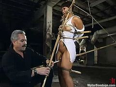 Kinky Asian chick gets tied up and then toyed with big dildo. Later on her master turns powerful jet of water on her pussy.