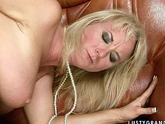 Extremely arousing fuck scene featuring sizzling blonde mommy. She is sucking hard flesh deepthroat until she starts gagging. She also gives hot titjob rubbing hard dong between her boobs. Then she bends over the couch getting hammered deep in her cunt from behind.