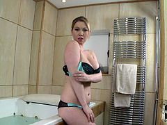 Lascivious blonde BBW takes off tempting lingerie exposing her natural big boobs. Then she gets in the bath tub bathing with joy.