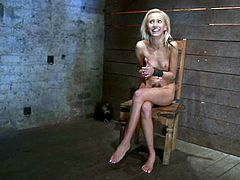 Petite blonde girl gets tied up by a guy in a mask in some barn. Then he fixes metal weight to her nipples and puts a ball gag in her mouth.