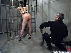 Sexy chick gets undressed and humiliated in a prison ward. Then she gets her pussy toyed and showered with powerful jet of water.