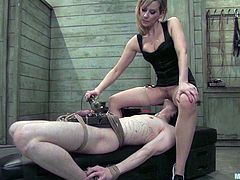 Hot blonde mistress ties the guy up. Then she fixes claws to his dick and steps on his balls. Later on she whips and toys his long-suffering ass.