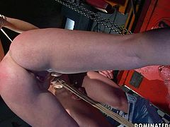 Horny stud knows how to teach this chick some good manners. He ties her up to ensure she can't wiggle her hands free. Then he makes her worship his cock. Poor chick sucks that throbbing erection greedily like a dirty whore. After a while he pounds her twat from behind.