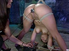 Sexy brunette mistress Isis Love is having fun with Jynx Maze in a basement. She binds Jynx and pleases her with fingering and then smashes her nice pussy with a wired dildo.