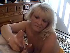 Mature slut with huge melons is on her knees sucking that cock and makes it hard to place it between her big boobs for perfect titjob.