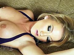 Madison Scott masturbates with her fingers at first. She lubricates a dildo with her mouth and inserts it in her wet pussy.