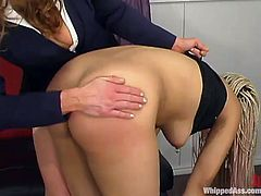 Sexy brown-haired dominatrix Kym Wilde is having fun with bad blonde girl Velvet Rose. Kym humiliates Velvet and then tears her vag apart with a strapon.