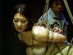 Horny japanese milf Mio Takahashi enjoys hardcore bondage. SHe is all tied up and hot her tight pussy stretched with a big dildo. But she enjoyed some heavy pounding too!