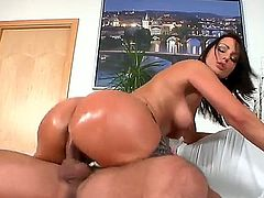 Dark haired bitch Simone Style with huge jaw dropping ass and cheep make up in lingerie and high heels rides on young stud Meeo to loud orgasm in living room action.