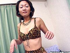 Slender Japanese mature in raunchy leopard-printed lingerie and fishnet stockings shows off her charms on cam before she sits with legs wide open to finger her hairy vagina through panties in solo sex video by Pornstar.
