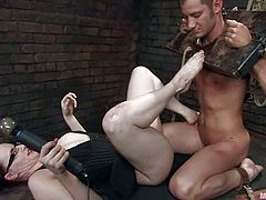 Lewd dominatrix Claire Adams is having fun with a guy called Nomad in a basement. She binds the dude and attaches clothespegs to his body and then pokes toys into his tight butt.