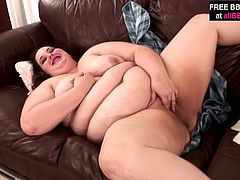 Lustful brunette wench with huge round body shape takes off her clothes posing in front of the camera. After strip tease she starts playing with her coochie using glass sex toy. She flirts for cam teasing you.
