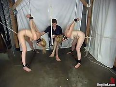 These two desirable and slender blond babes are getting tortured together. Babes are bondaged and their master feels like he is in heaven.