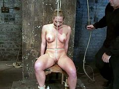 Isis Love is playing BDSM games with a busty blonde mom. Isis binds the skank and rubs her cunt with a rope and then decorates her massive natural tits with weights.