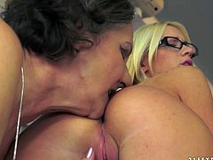 Salacious old lesbian Kata is playing dirty games with cute blonde Kiara Lord. The women make out and then enjoy licking each other's hot pussies.