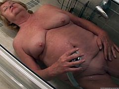 Hussy old blonde gives blowjob to young raunchy dude in the shower. Watch kinky Fame Digital sex tube video if you like sex with old mature sluts.