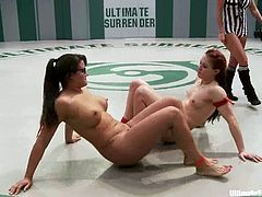 Two girls fight against two other chicks. Girls in red bikini lose a battle, so they lick each others pussies and get humiliated in a ring.