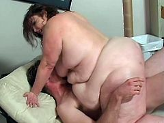 BBW lady gets fucked missionary by horny BBW lover guy. She is also fingered in her fat and juicy pussy until she cums hard.