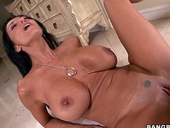 The first thing you'll notice out of this brunette milf are her big round breasts. Take a look at them as well as she takes a ride on this guy's big cock.