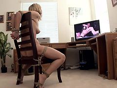 She's tied on the chair and has a vibrator on her clit while on the screen there's a porn. After this warm up, the guy ties her hands and fucks her pussy really hard. He grabs her hair roughly and continues to pussy drill the fragile blonde. His friend comes to help, lubes her pussy and fingers her hard!