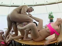 Claudia Rossi and Kathy Anderson are getting naughty with some man in the kitchen. They drive him crazy with an awesome blowjob and then jump on his manhood by turns.