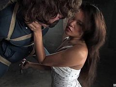 Dorian gets tied and suspended by nasty Annie Cruz. Later on he sucks big dildo and gets his ass completely by a fucking machine.