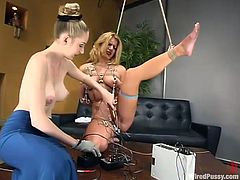 Horny Jenni stands on all fours on a coffee table being tied up. She gets her pussy toyed and tits tortured with electricity.