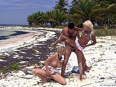 Boroka Balls and Tarra White take bikini off and give a blowjob to some guy. After that they get fucked hard in their tight asses right on the beach.