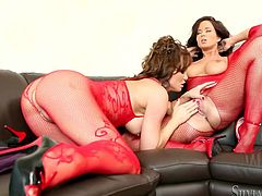 Two jaw dropping babes wearing sexy red body fishnets have sex fun with transparent sex toy. One babe fucks another one and make her licks off juice.