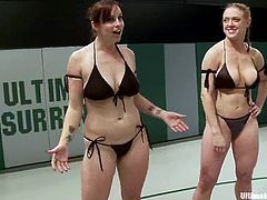 Nasty chicks in bikini fight after arm-wrestling. Then these girls also finger each others soaking pussies right in a ring.