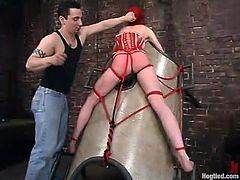 Slender redhead siren Lory Vixen is under BDSM perversion