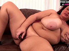 Sultry mom with curvaceous body shape kneads her boobs in her hands in front of the camera. After she takes off her clothes she masturbates with dildo.