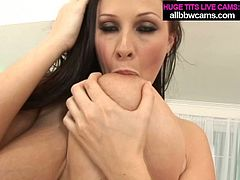 Splendid brunette MILF with giant boobs is giving a head in steamy porn clip