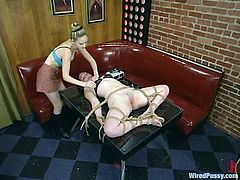 The submissive ginger is getting toyed and tortured with other kinky devices in this BDSM lesbian video packed taking place in a restaurant.