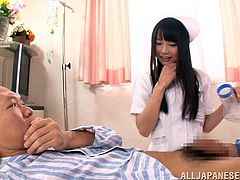 This cute nurse goes to check on one of her patients and to see if he has to go to the bathroom. She can't get him to go so she decides to give him a blowjob find out if that will help. She wraps her lips around his stiff cock and sucks him off. Then, he rubs her tits over her nursing uniform.