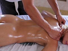 Stunning blonde gets more than massage from hunk eager to feel her